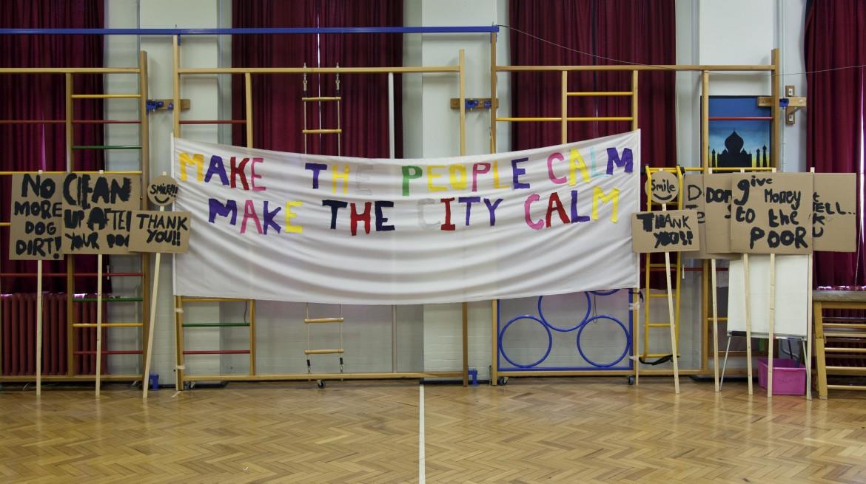 Image 2 - Peter Liversidge, Notes on Protesting, school rehearsal, April 2014. Cotton, iron on, cardboard & wood. © Peter Liversidge