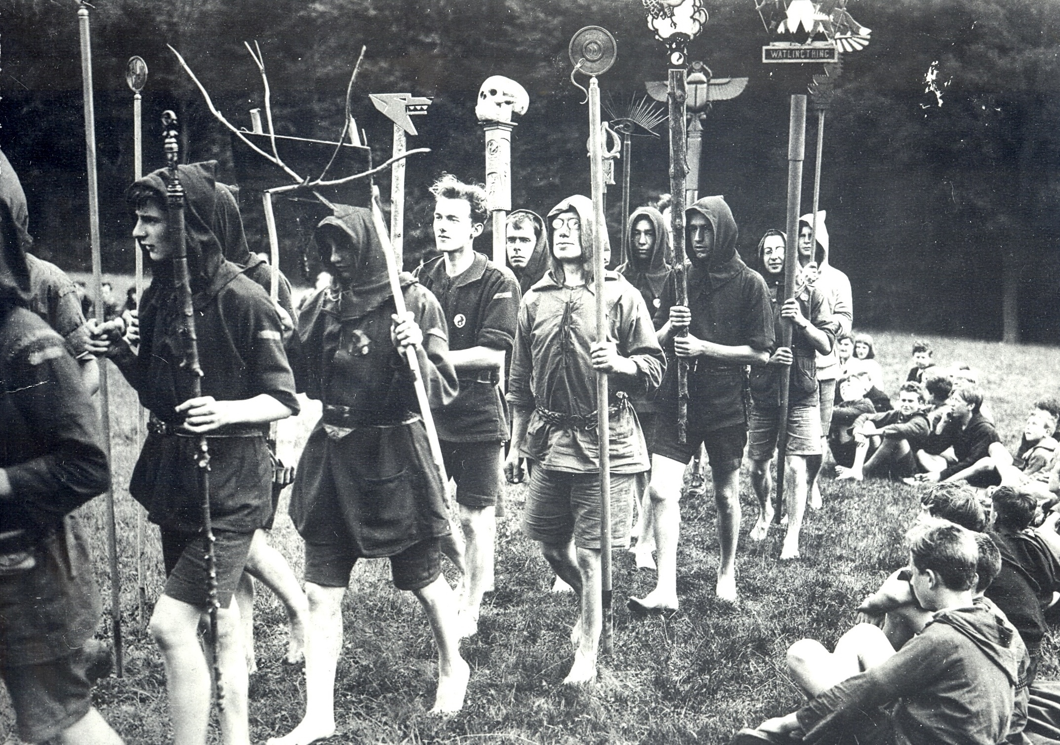 Image-5-Kibbo-Kift-Kindred-men-and-boys-on-camp-parade-with-totems-1925.jpg