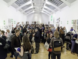 An image showing many people attending the London Art Book Fair. Many of them are reading books artist