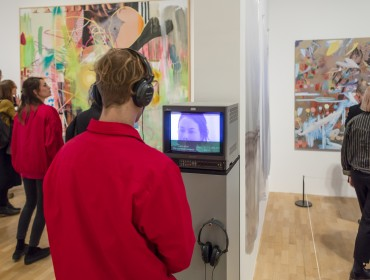 A man listens to an audio artwork in the Whitechapel Gallery exhibition