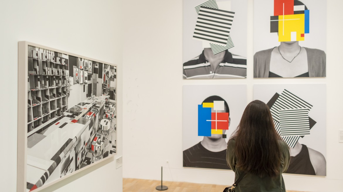 A woman looks at works by Douglas Coupland in Whitechapel Gallery exhibition