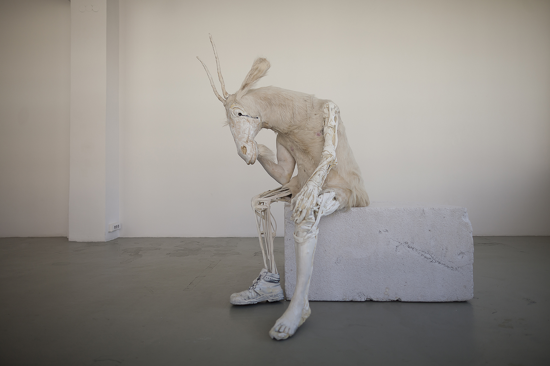 Pawel Althamer, Self-Portrait as the Billy-Goat, 2011 Glazed ceramic, plastic, metal, resin cast, goat fur, used shoe, painted Styrofoam plinth, 152 x 152 x 154 cm, Courtesy the artist and Foksal Gallery Foundation, Warsaw, Photo: Bartosz Stawiarski